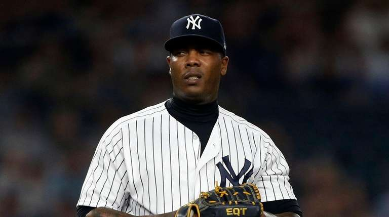 Yankees pitcher Aroldis Chapman looks on during the