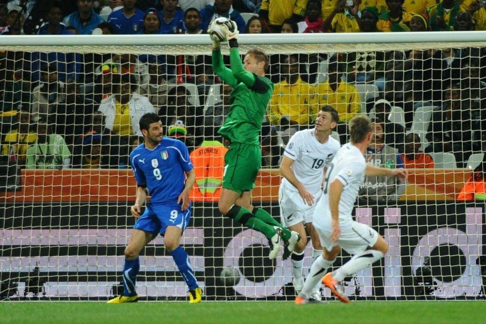 New Zealand's goalkeeper Mark Paston (C) makes a
