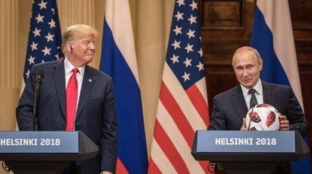 Russian President Vladimir Putin hands U.S. President Donald