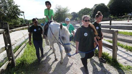 Volunteers Nolani Kennedy-White, Alanna Barnes and Jamie Holzmann