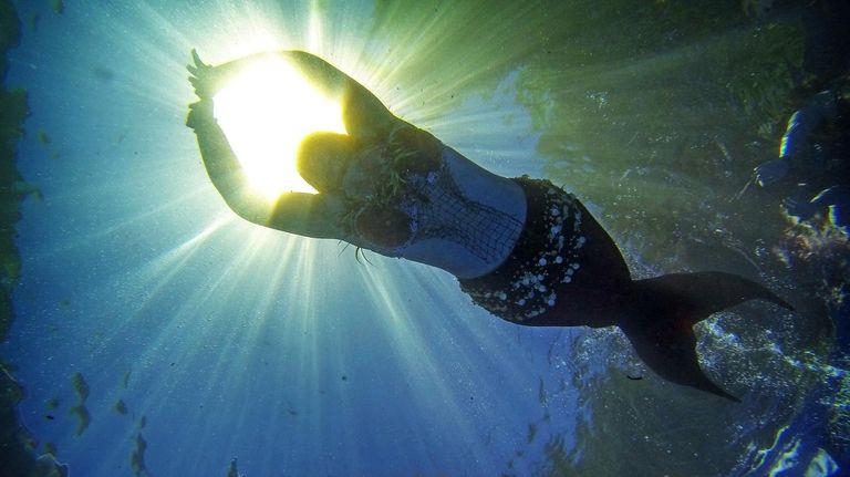 Mary Grecco (aka Mermaid Rose) shines during a