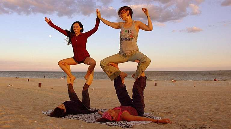 Certified Acro Yoga instructor, Donna Squires, top right,