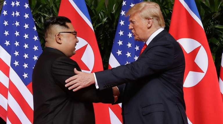President Donald Trump meets North Korea leader Kim