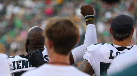 Malcolm Jenkins of the Philadelphia Eagles raises his