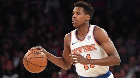 Knicks guard Frank Ntilikina dribbles the ball up