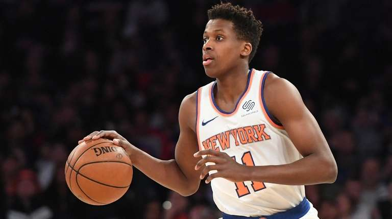 Knicks guard Frank Ntilikina dribbles the ball up