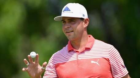 Gary Woodland of the United States acknowledges the