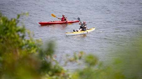 Kayakers explore near Adler Island off Point Lookout
