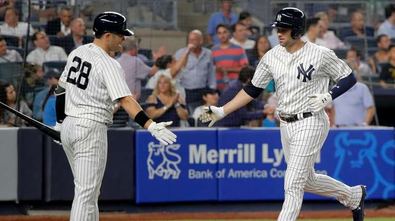 Neil Walker, right, is congratulated by Austin Romine