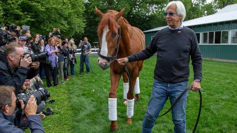 Triple Crown winner Justify outside the stable with
