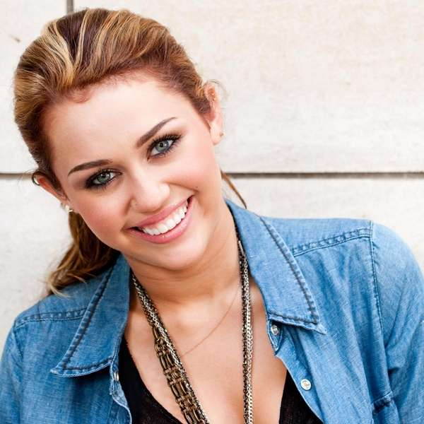 Singer and actress Miley Cyrus poses for a