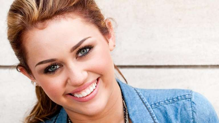 Miley Cyrus poses for a portrait in New