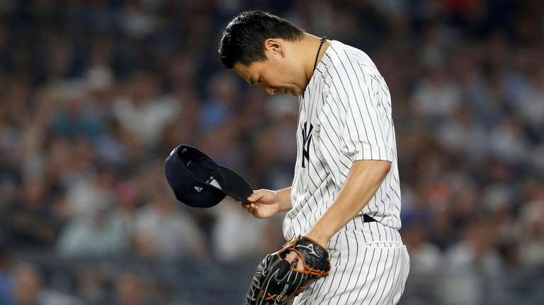 Masahiro Tanaka of the Yankees reacts after surrendering