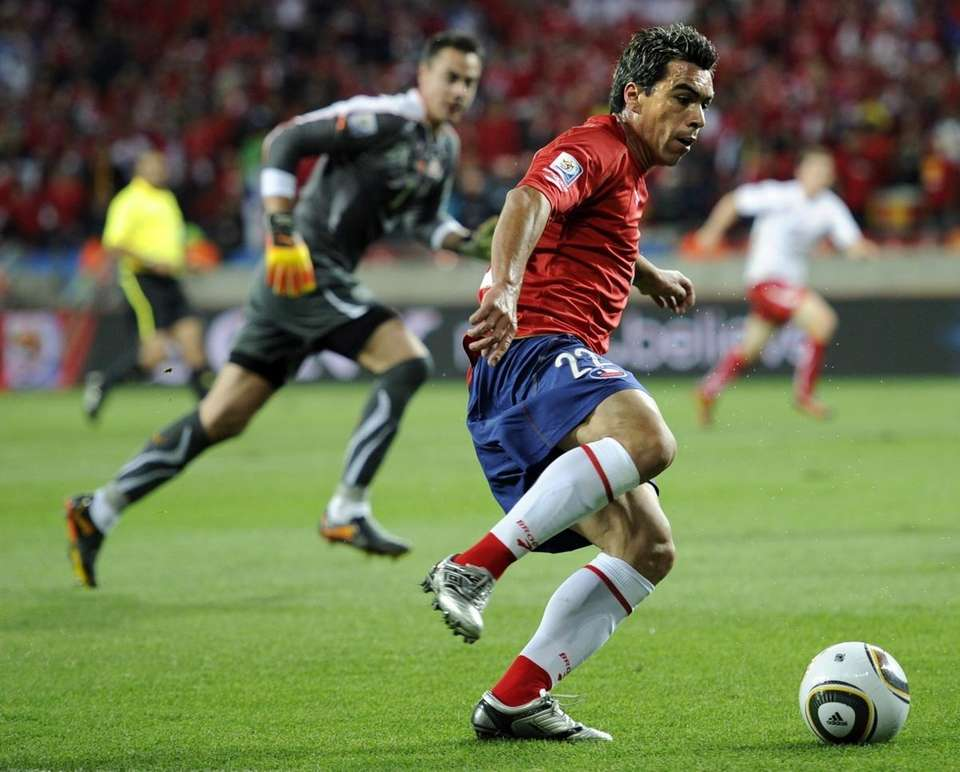 Chile's Esteban Paredes is about to pass the