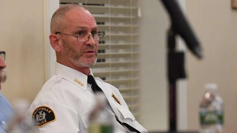 Amityville Police Chief Glenn Slack during a meeting