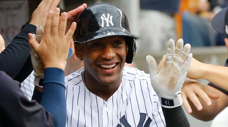 Miguel Andujar of the Yankees celebrates his seventh