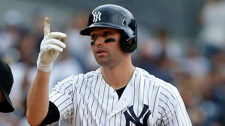 The Yankees' Neil Walker reacts after his sixth-inning