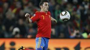 Spain's striker David Villa controls the ball during
