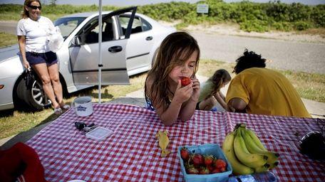 Bayville resident Madeline Mullen, 6, munches on strawberries