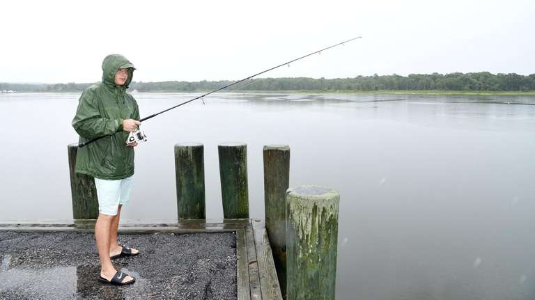 Alec Bjorkland, 19, of Westchester, fishes in the