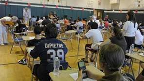 Eighth-grade students prepare to take a Regents exam.