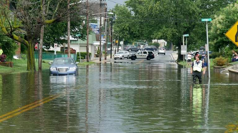 Heavy rains flooded streets on Long Beach Road