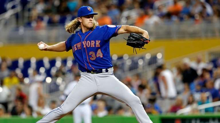 Mets starting pitcher Noah Syndergaard throws against the
