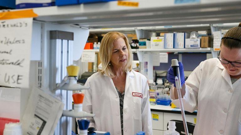 Dr. Ellen Unterwald, left, oversees graduate student Krista