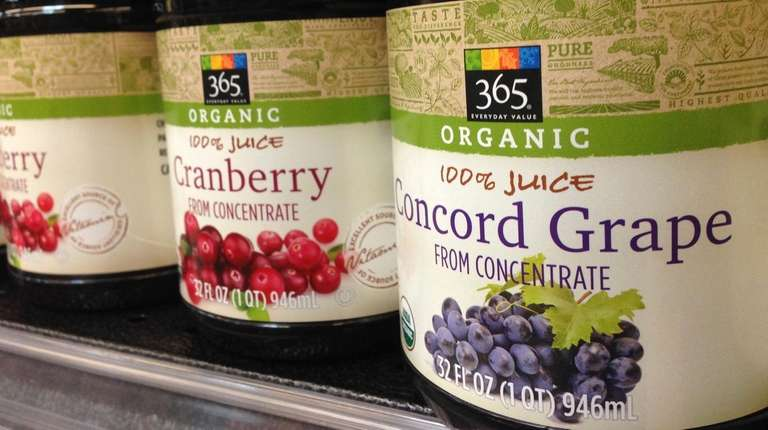 Bottles of organic fruit juice at a Whole