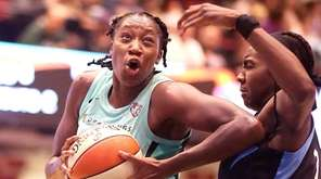 The Liberty's Tina Charles goes in hard against
