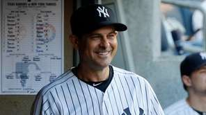 Manager Aaron Boone of the Yankees smiles before