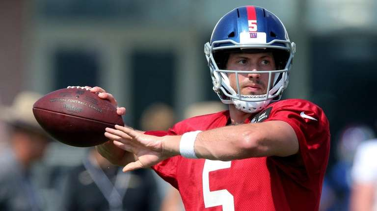 Giants quarterback Davis Webb throws a pass during