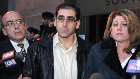 Contractor William Rapetti, center, leaves Manhattan criminal court