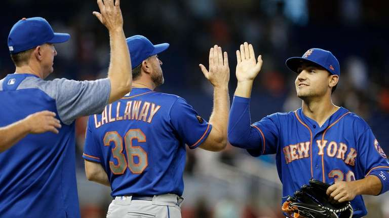 Mets leftfielder Michael Conforto, right, celebrates with manager