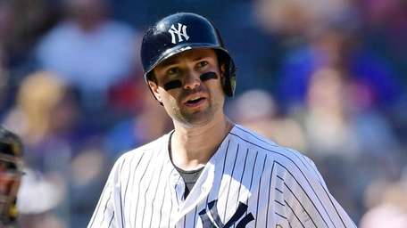 Neil Walker of the Yankees reacts after striking
