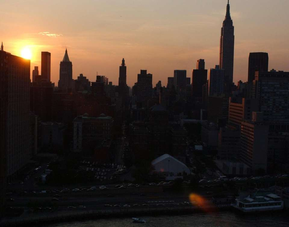 The sun sets over Manhattan during the first