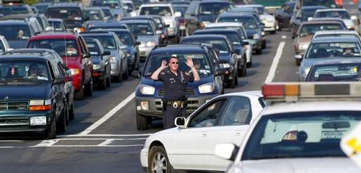 A Nassau county police officer tries to direct