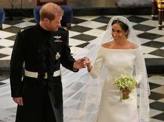 Britain's Prince Harry and Meghan Markle leave after