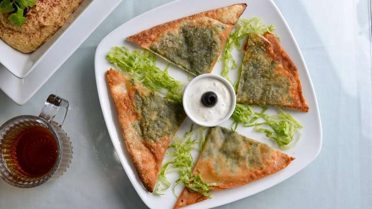 Bolanee, or fried pastry stuffed with spinach, at