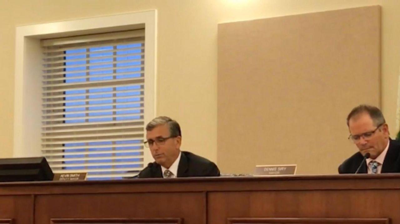 Amityville Deputy Mayor Kevin Smith and attorney Glenn