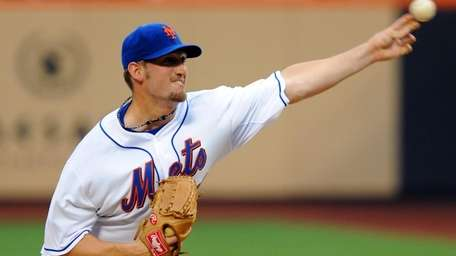 New York Mets' Jon Niese (49) pitches to