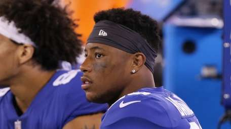 Giants running back Saquon Barkley sits on the