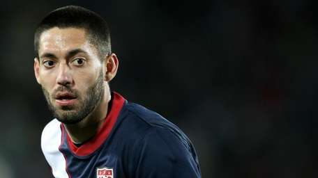 Clint Dempsey of the United States looks on