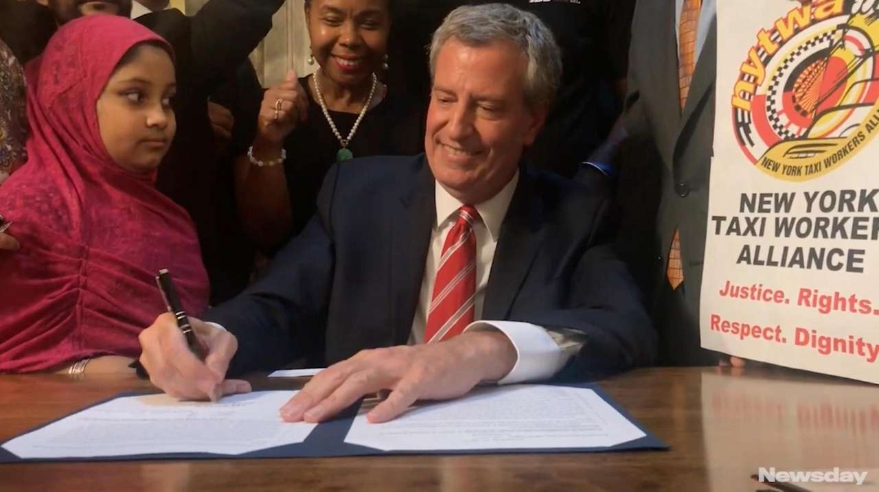 NYC mayor signs legislation regulating Uber
