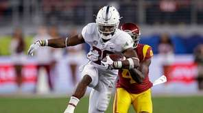 Stanford running back Bryce Love runs in front