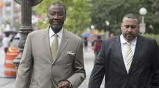 Norman Seabrook, left, arrives at a federal courthouse