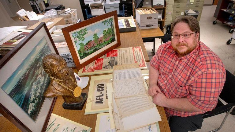 Adelphi University archivist David Ranzan is shown with