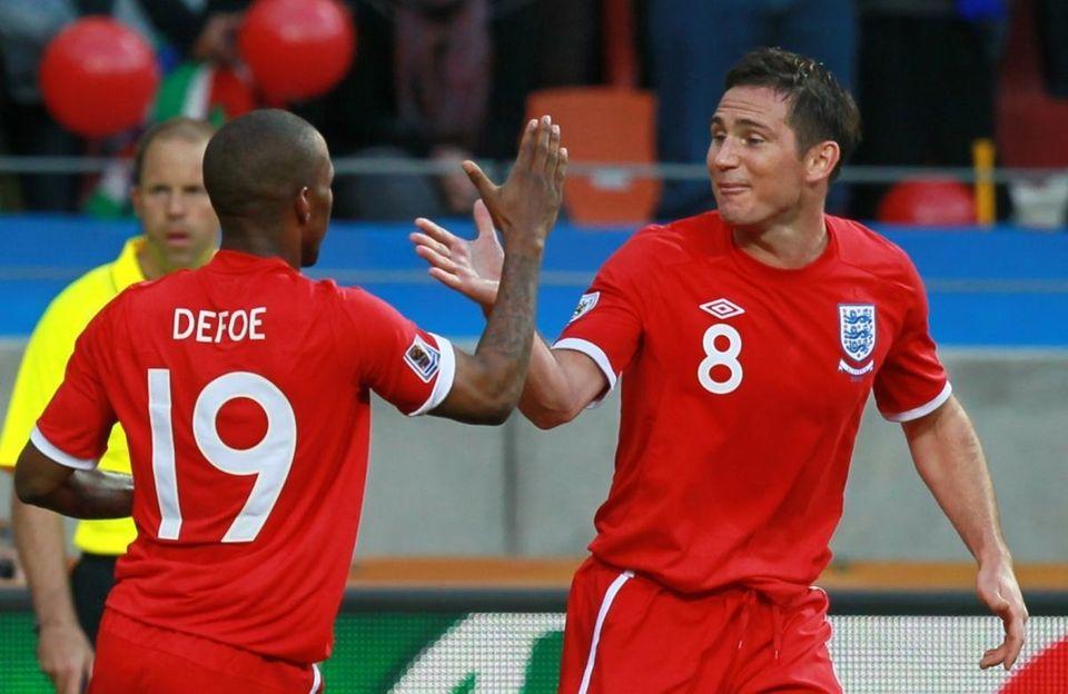 England striker Jermain Defoe, left, celebrates with England's