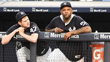 Yankees pitcher CC Sabathia looks on from the