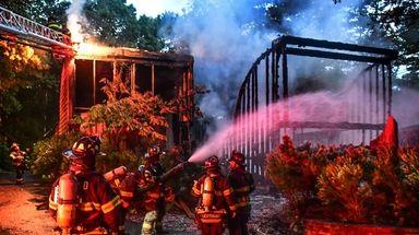 Firefighters battle a blaze that broke out on
